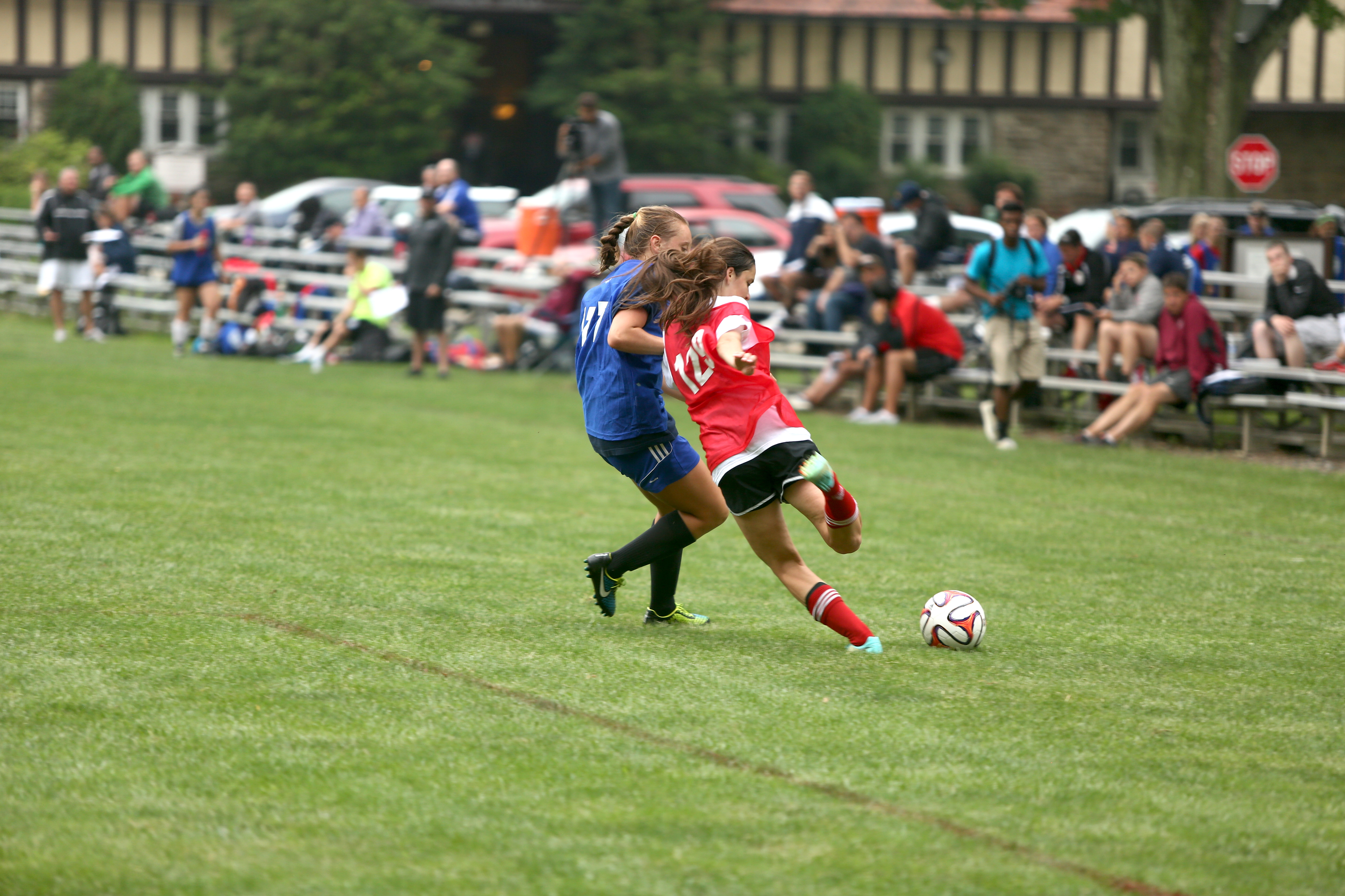top girls soccer camps in front of coaches